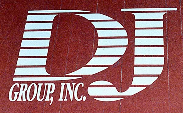 a close up of a sign that reads 'DJ Group, Inc.'