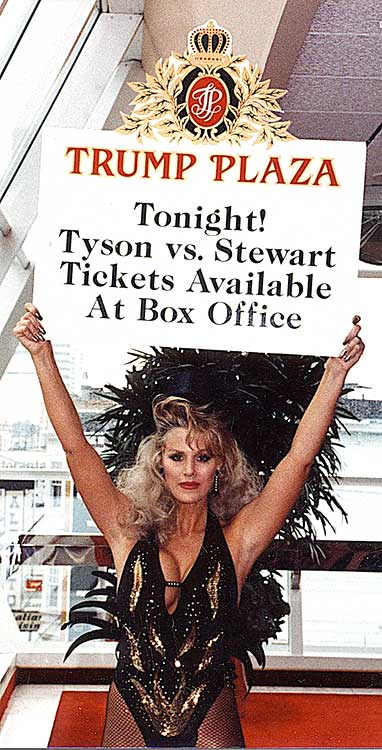 a female employee at Trump Plaza holding a 'round card' designed by Norman Dee Associates that reads 'Tonight! Tyson vs. Stewart Tickets Available At Box Office'