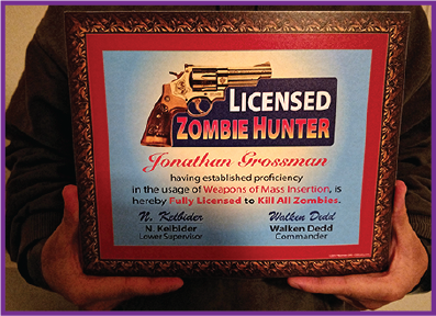 A physical sample of our Licensed Zombie Hunter license mounted onto posterboard. It reads 'Licensed Zombie Hunter - Jonathan Grossman - having established proficiency in the usage of Weapons of Mass Insertion, is hereby Fully Licensed to Kill All Zombies. - N. Kelbider, Supervisor - Walken Dedd, Commander'.